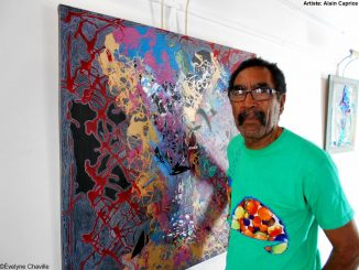 "The Martinican plastic artist, Alain Phoébé Caprice, in front of his work called ""Èskarpen"" (Pumps). Photo: Évelyne Chaville"